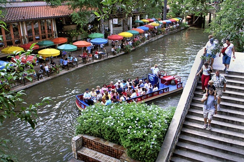 "No trip to San Antonio is complete without a visit to the <a href=""http://www.frommers.com/destinations/sanantonio/A7646.html"" target=""_blank"">Alamo</a> (tel. <strong>201/225-1391</strong>; <strong><a href=""http://"" target=""_blank"">www.thealamo.org</a></strong>), a former Spanish mission turned battle site that made heroes of such men as William Travis and Jim Bowie. Kids and adults together can enjoy wandering the historic grounds and learning about the famous 1836 battle, in which Texans held off a siege by Santa Ana and his troops for 13 days before finally surrendering with only two men left standing. Nearby, families can enjoy the scenic San Antonio River Walk (<strong><a href=""http://www.thesanantonioriverwalk.com"" target=""_blank"">www.thesanantonioriverwalk.com</a></strong>), a rambling paved arcade of restaurants, shops, and bars that follows the banks of the San Antonio River. Pockets of the pedestrian walkway are downright peaceful; others are more raucous, and perhaps not as appealing to families. Boat tours and water taxis are available at points throughout the scenic area. Near downtown is the AT&amp;T Center, where families can enjoy watching the hometown <a href=""http://www.frommers.com/destinations/sanantonio/0027010021.html"" target=""_blank"">Spurs</a> shoot some hoops. The top-tier team plays home games between October and May (and June, if they're lucky!). Though they didn't make it all the way this year, Tim Duncan, Tony Parker, Manu Ginobli, and the rest of the fellas will no doubt start strong in the fall. If you're visit coincides with a home game, be sure to catch one.<br><br><em>Photo Caption: Pedestrians, boaters, and restaurant patrons along San Antonio's River Walk.</em>"