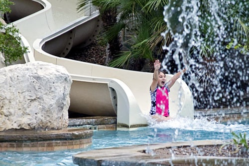 "Though there's plenty of fun to be had throughout the central Texas city, your family could check-in to the <a href=""http://www.frommers.com/destinations/sanantonio/H38818.html"" target=""_blank"">Westin La Cantera</a> (tel. <strong>210/558-6500</strong>; <strong><a href=""http://www.westinlacantera.com"" target=""_blank"">www.westinlacantera.com</a></strong>), never leave the property, and still make fabulous memories in San Antonio. Perched on a hilltop 15 miles from downtown, the resort looks out over San Antonio and the surrounding Texas Hill Country. Among the more than 500 guest accommodations available are standard doubles, suites, and the more private casitas, ""little houses"" which have private porches and ample, luxurious living space. From the pools to the golf courses to the kid camps, there is something for every member of the family. The younger kids can splash around in one of the Lost Quarry pools, which occupy 17,000 square feet, or sign-up for Discovery Junction, a kids program that offers activities ranging from arts and crafts to water balloon tosses to movie nights under the stars. Teens can hang out at Rock'n T Lounge playing video games, watching movies, or testing their rock star potential with a round of Guitar Hero.<br><br>Meanwhile, mom and dad can hit the links and take advantage of scenic 18-hole championship golf courses, one of which was designed by Arnold Palmer. They can also enjoy the full-service fitness center and spa or take a dip in the adult-only pool. Most of the on-site eateries are family friendly, too. The staff at Westin La Cantera couldn't be nicer. Everyone from the valet parking attendants to the restaurant servers is friendly here. When and if you ever feel like leaving the resort, the whole family can catch a hotel shuttle and head directly to the renowned Shops at La Cantera (15900 La Cantera Parkway; tel. <strong>210/582-6255</strong>; <strong><a href=""http://www.theshopsatlacantera.com"" target=""_blank"">www.theshopsatlacantera.com</a></strong>), a world-class shopping center with stores such as Tiffany's, Neiman Marcus, and Betsey Johnson. In addition to nearby shopping, Fiesta Texas and Sea World are also closeby. The resort runs shuttles (on request) to these destinations as well as to points downtown and elsewhere in the city.<br><br>While the La Cantera location might be the place to hole-up on the property, a family-friendly option downtown is the <a href=""http://www.frommers.com/destinations/sanantonio/H38813.html"" target=""_blank"">Westin Riverwalk Inn</a> (tel. <strong>800/937-8461</strong>; <strong><a href=""http://www.westin.com/riverwalk"" target=""_blank"">www.westin.com/riverwalk</a></strong>). Featuring many of the same amenities as the Westin La Cantera, including Westin's famous Heavenly Beds, this location, on the River Walk, is ideal for families who want to be in the center of the action. With child-oriented perks, such as bedtime stories told over the phone and kids' treat packs handed out at check-in, this is a good option for parents who want easy access to the attractions downtown without compromising family value.<br><br><em>Photo Caption: The pool at Westin La Cantera.</em>"