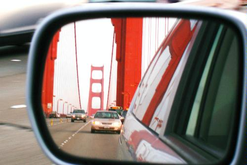 A reflection of the Golden Gate Bridge in a rearview mirror. San Francisco, California.