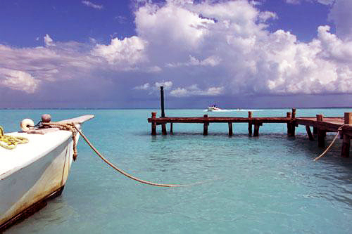 Dock and crystal clear waters in Cancun, Mexico