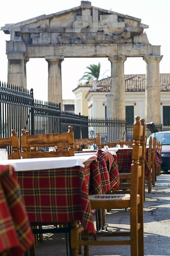 Cafe with plaid tables in Roman Agora, Athens