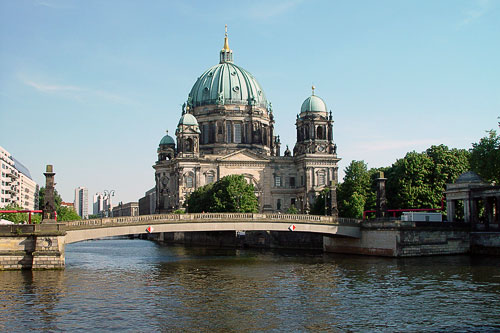 View of an arched bridge and The Berliner Dom over the East Berlin canal