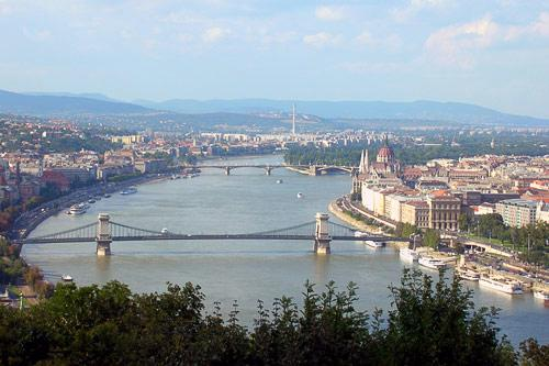 A bridge over the Danube River separates the cities of Buda and Pest, Hungary.