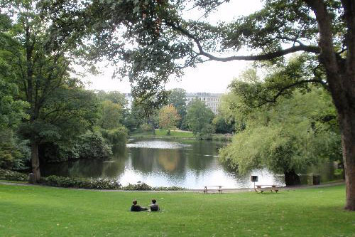Couples sit in the Hans Christian Orsted Park in Copenhagen