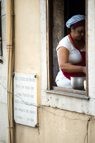 Cooking at the window in Lisbon, Portugal.