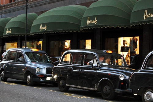 London cabs waiting outside the Harrods department store.
