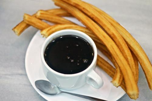Few live in, or visit, Madrid without stopping at Chocolatería San Ginés for churros con chocolate.