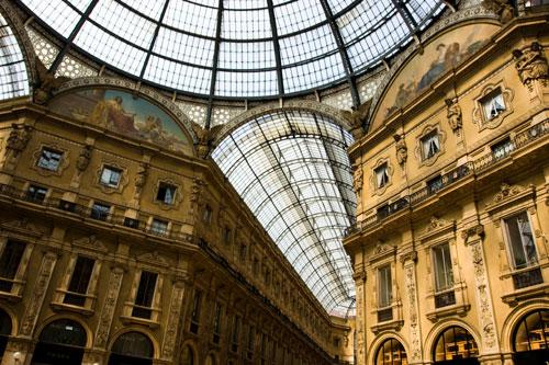 The Galleria Vittorio Emanuele II is a covered double arcade formed of two glass-vaulted arcades at right angles intersecting in an octagon; it is prominently sited on the northern side of the Piazza del Duomo in Milan, and connects to the Piazza della Scala