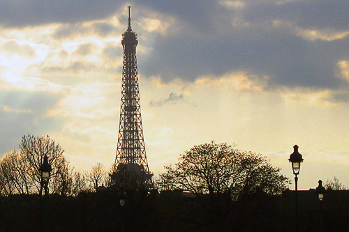 Silhouette of the Eiffel Tower as the sun sets in early April.