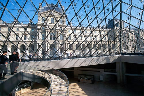 Inside looking out of the glass pyramid that stands in the courtyard of Le Louvre Museum and provides the entrance to the three main underground areas.