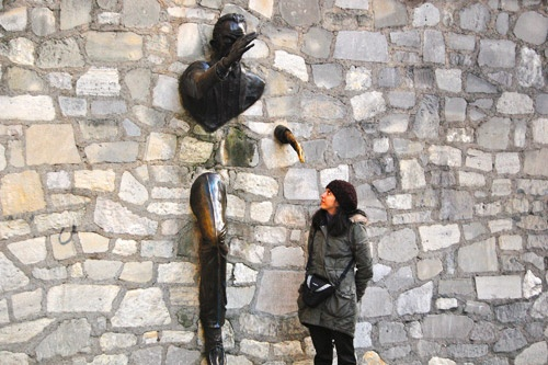 Le Passe-Muraille, a sculpture in Montmartre, Paris, is based on a short story of the same name.