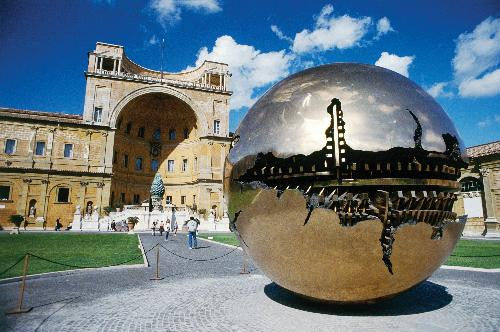 A view of the Vatican Museum in Rome, dominated by the golden sphere that stands outside,