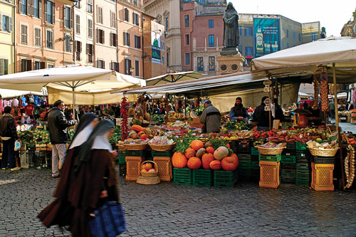 Giordano Bruno statue surrounded by the Campo dei Fiori market stalls in Rome