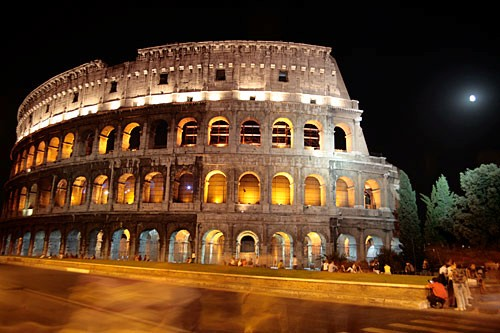 The Colosseum's dramatic exterior features Doric, Ionic, and Corinthian columns.