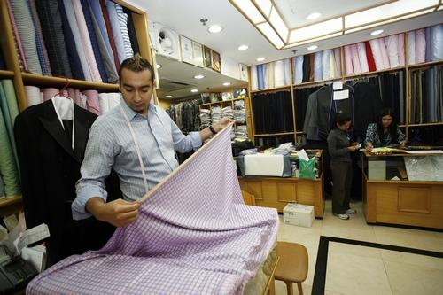 The tailors at Sam's are world-famous for their custom-made suits and shirts.