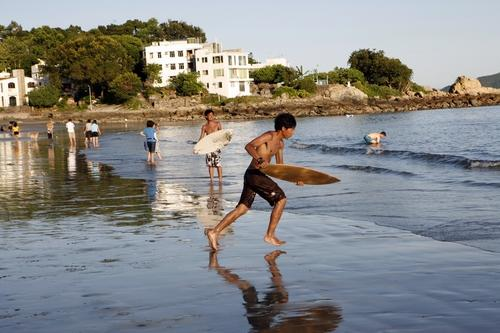 Skim boarding is a popular pastime on Hong Kong's beaches.