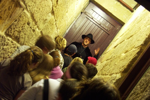 Visitors can journey from this world to the convict colony of The Rocks and uncover eerie folklore, ghostly tales and haunted sites of Sydney. Photo Courtesy Spirit of Sydney / The Rocks Ghost Tours
