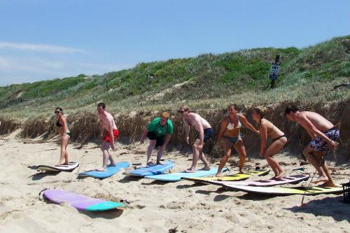 Students learn the proper way to stand on a board during a lesson at Waves Surf School in Sydney, Australia.