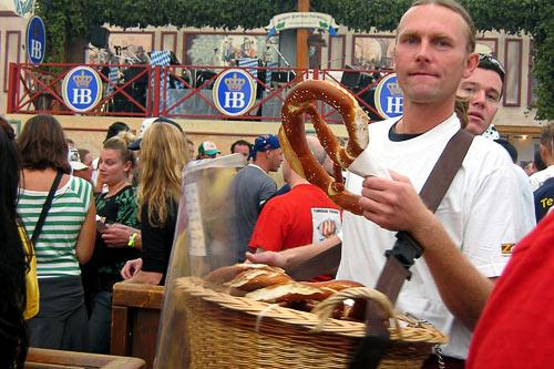 A vendor sells <em>brezel</em> (a giant soft pretzel) by the basket.