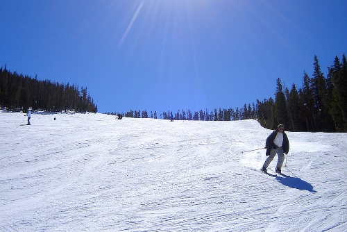 Skiers headed downhill at Winter Park.