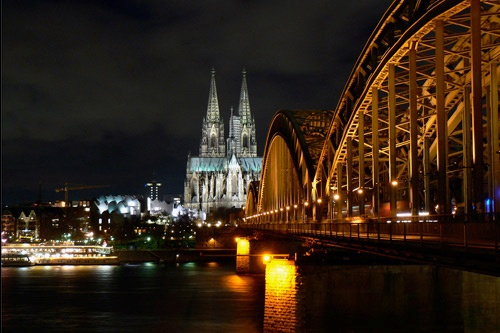 Cologne Cathedral and Hohenzollern Bridge with the floating Christmas market on the Rhine, at left.
