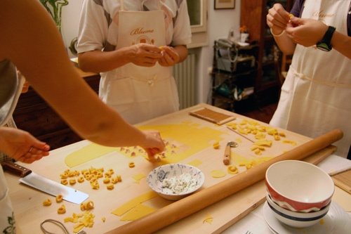 During a class at Bluone Cooking Tours in Italy, students learn to make tortellini from scratch. Photo: Bluone Photo