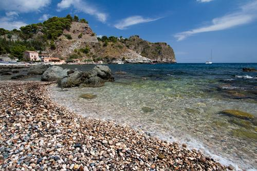 Beautiful pebble beach in Taormina, Sicily