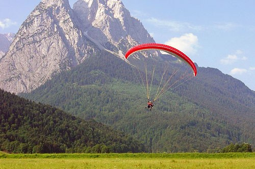 A paraglider enjoys the bird's eye view of the alps in Garmisch-Partenkirchen, Germany.