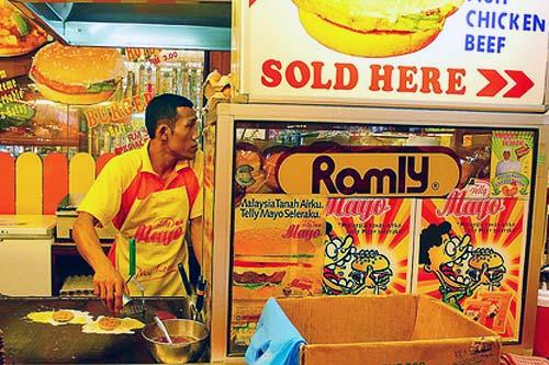 In Kuala Lumpur, the Ramly Burger typically includes an egg-wrapped patty.