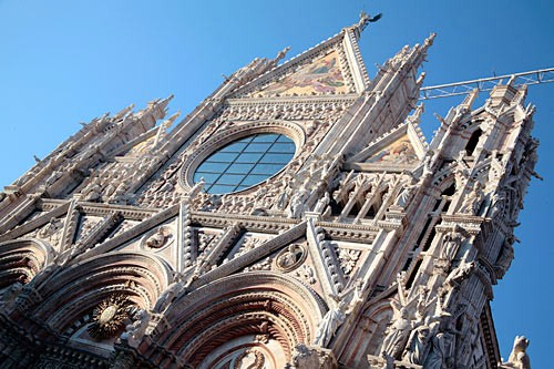 Siena's Duomo is striking, from its Romanesque-Gothic facade to its marble-striped, exuberantly decorated interior.