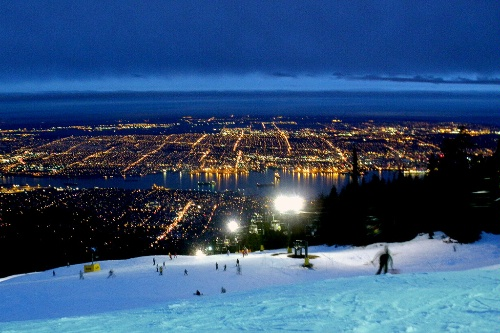 Nighttime view of downtown Vancouver, British Columbia from the slopes of Grouse Mountain.