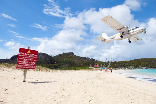 Plane ascending from St. Barts small airport.