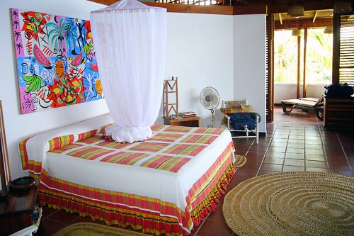 Madras prints cover beds at Anse Chastenet resort.