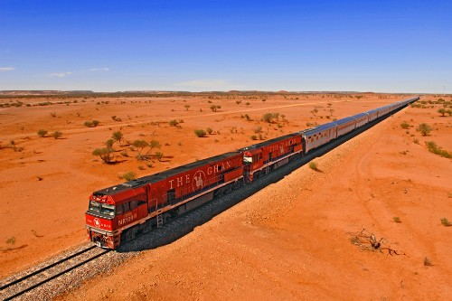 The Ghan runs between Adelaide to Darwin, through most of Australia.