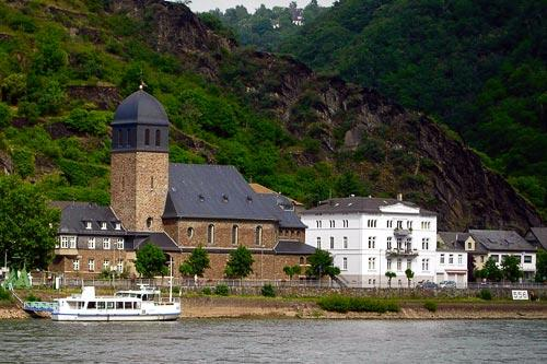 Houses along the Rhine River in Germany, as seen from a river cruise.