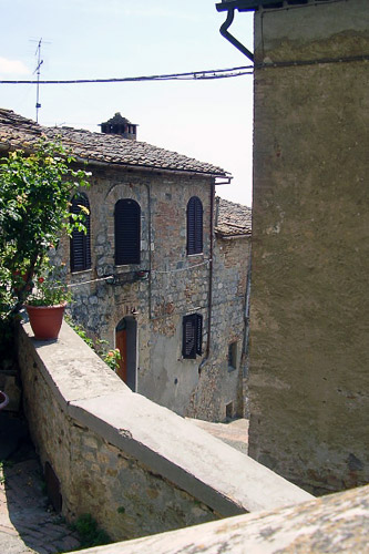 view of an old, narrow street in San Gimignano-Italy