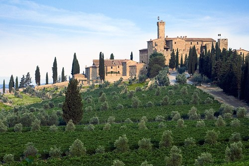 The grounds of Castello Banfi encompass a Michelin-star restaurant, accommodations in stone cottages, and a Glass Museum.