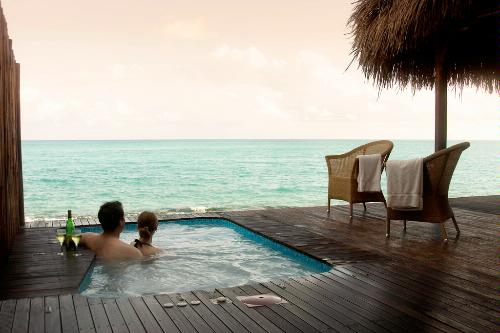 Couple enjoying the Plunge Pool at Medjumbe Resort, located on a private island off the coast of Mozambique.
