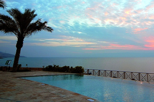 View of the Dead Sea at sunset from the pool deck of Mövenpick Dead Sea