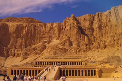 The Mortuary Temple of Queen Hatshepsut, situated beneath the cliffs at Deir el Bahari on the west bank of the Nile River .