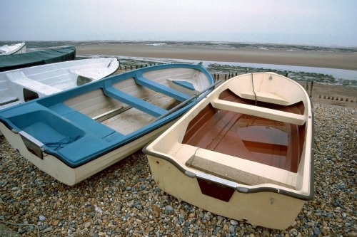 Boats along the Sussex shore in Hastings, England.