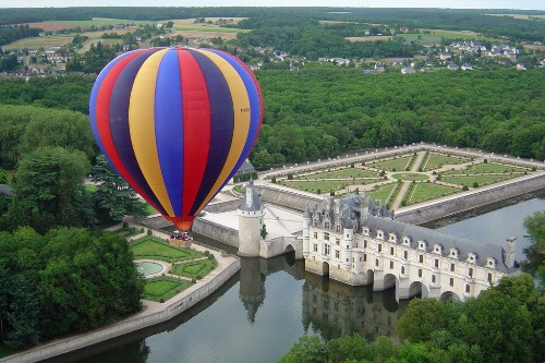 Balloon rising over Chateau de Chenonceau, Loire Valley, France.