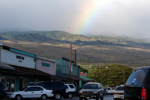 Downtown Kaunakakai, Molokai. Background shows rainbow on East Molokai Volcano.