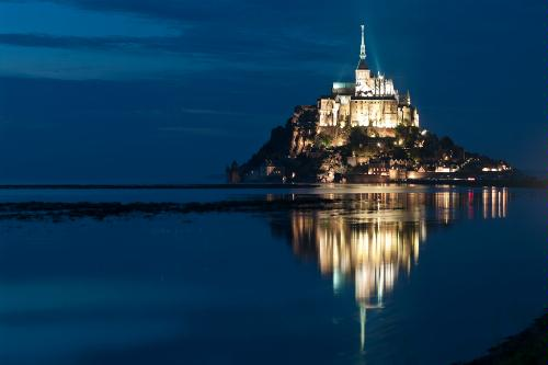 The island of Mont-St-Michel at sunset in France.
