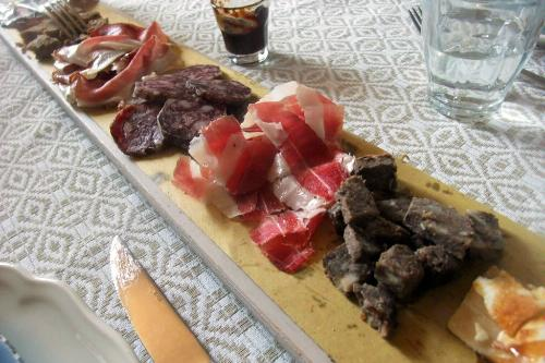A selection of cured meats at Fattoria Il Monte near Roncofreddo, Italy.