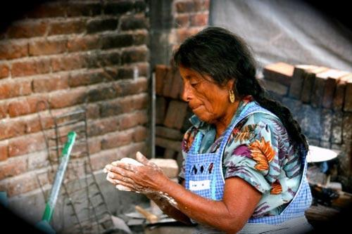 A woman makes tortillas in Oaxaca, Mexico.