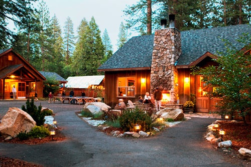 The plaza of the Evergreen Lodge at dusk. Courtesy Jae Feinberg