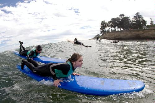 Instructor and student at Richard Schmidt Surf School, Santa Cruz.