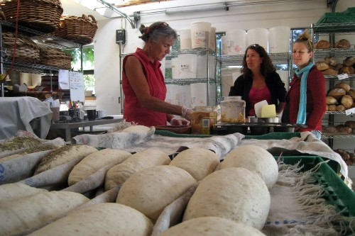 "The ""Bread Lady"" Heather Campbell (left) seasons bread in her shop."