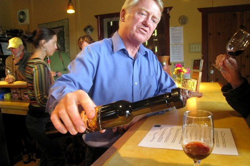 Salt Spring Vineyards owner Dev McIntyre offers a tasting of the blackberry port.